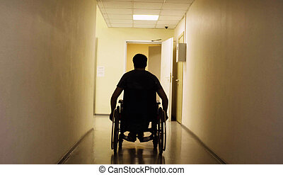 Silhouette of disabled man in a wheelchair in the rehabilitation center