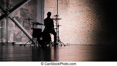 silhouette of drummer man to play the drums - Anonymous...