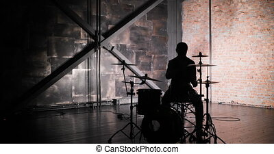 silhouette of drummer man to play the drums