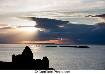 Silhouette of Dunluce castle in Northern Ireland