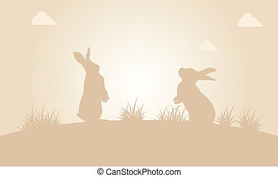Silhouette of easter bunny at sunset