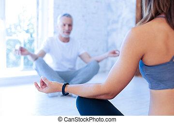 Silhouette of elderly man that doing yoga