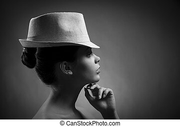 Silhouette of elegant lady in hat. BW Image