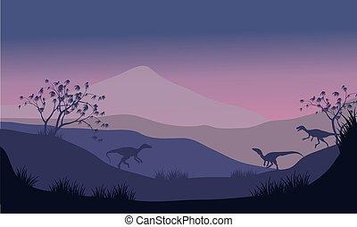 Silhouette of eoraptor in hills