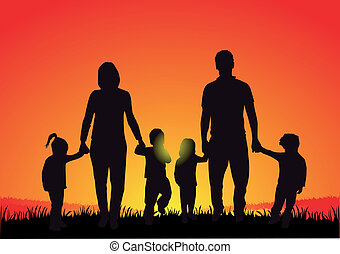 Silhouette of family at sunset .
