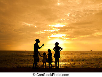 Silhouette of family at the beach