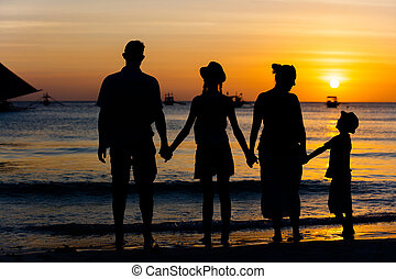 Silhouette of family on the beach