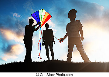 Family Playing With The Colorful Kite