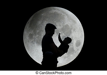 Silhouette of father and child with moon