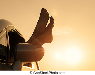 Woman relaxing in a car on road trip.