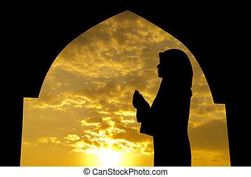 Muslim praying in mosque - Silhouette of Female Muslim...