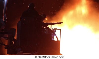 Silhouette of firemen on flames - Silhouette of firemen at...