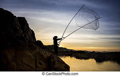 Silhouette of fishermen in Thailand