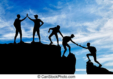 Silhouette of five climbers who overcome the drudgery of working in a team