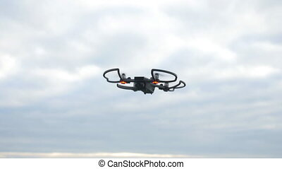Silhouette of flying personal drone - silhouette of flying...