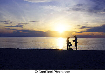 Silhouette of gay couple on the beach during sunset, Romantic sea with his love.