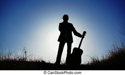 Silhouette of Girl and a Guitar