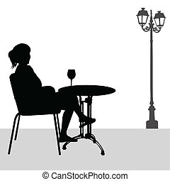 Silhouette of girl in cafe