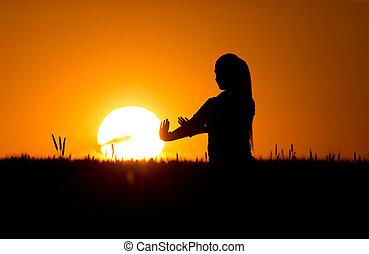 Silhouette of girl in wheat field