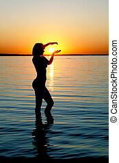 Silhouette of girl on sunset