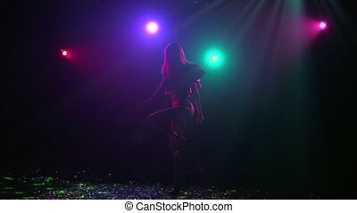 Silhouette of girl rhythmic movement of disco. Slow motion