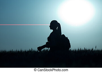 Silhouette of girl shooting in nature