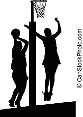 Silhouette of girls ladies netball players jumping and blocking goal