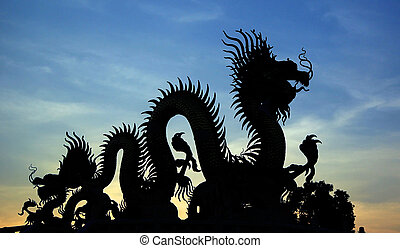 Silhouette of golden Chinese dragon