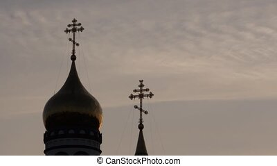 silhouette of golden church dome on sunrise sky, Christian...