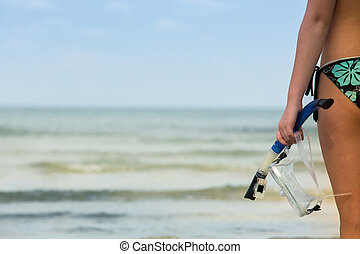 Silhouette of hand with snorkeling equipment - picture with space for text.