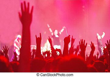 rock concert - silhouette of hands in a rock concert