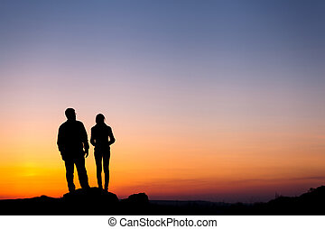Silhouette of happiness family against beautiful colorful sky. S