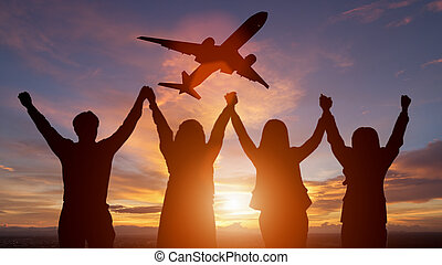 Silhouette of happy business team making high hands in sunset sky background for business teamwork concept and plane