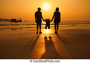 Silhouette of happy couple on the beach