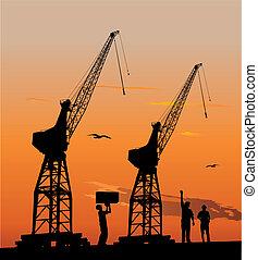 Silhouette of harbour cranes