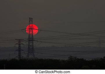 Silhouette of high voltage electric pillar