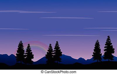 Silhouette of hill and tree at night