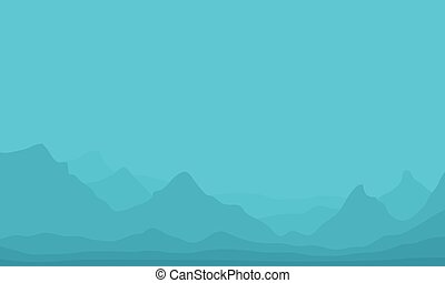 Silhouette of hills in fog