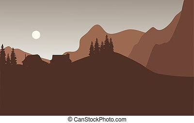 Silhouette of house on the mountain