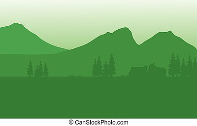 Silhouette of house with mountain background