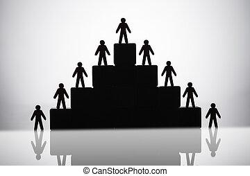 Human Figures Standing On Wooden Blocks