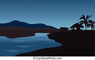 Silhouette of hut in riverbank