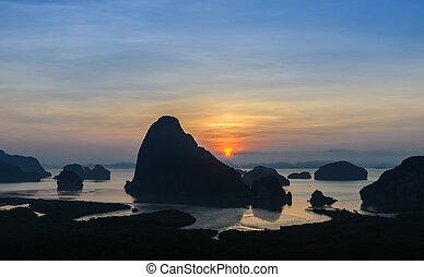 Silhouette of imestone karsts lanscape at sunrise
