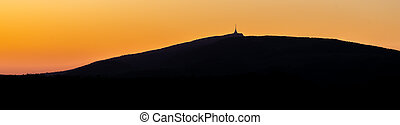 Silhouette of Jested mountain at sunset time