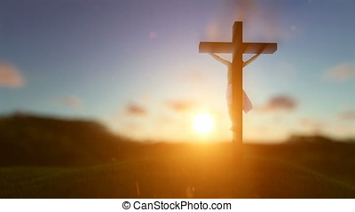 Silhouette of Jesus with Cross over sunset, religious concept, blurry background