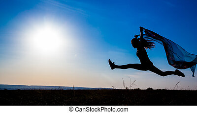 silhouette of  jumping girl against sunrise