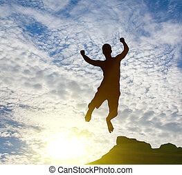 jumping man on sunrise