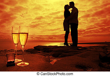 kissing couple - silhouette of kissing couple in the sunset