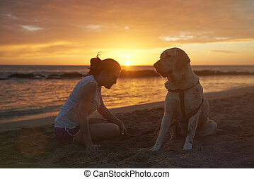 silhouette of labrador dog with woman