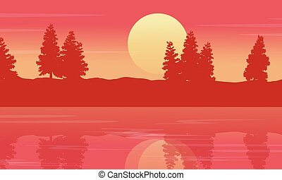 Silhouette of lake with spruce lined landscape